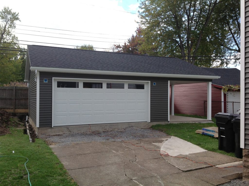 Detached garage with patio custom builders